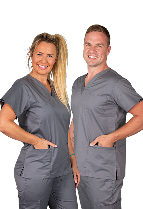 Male and female wearing Elitcare classic gray shirt and pants uniform